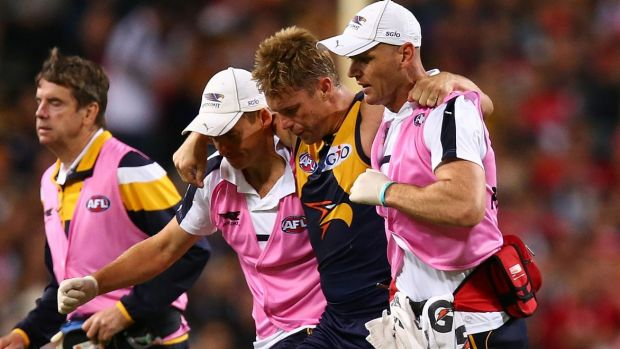 Sam Mitchell leaves the field after hurting his ankle against Sydney.
