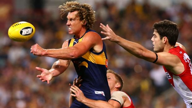 West Coast's Matt Priddis fires off a handball just in time.
