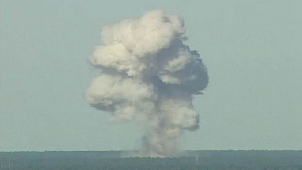 A rising mushroom cloud from a MOAB, from an Air Force video.