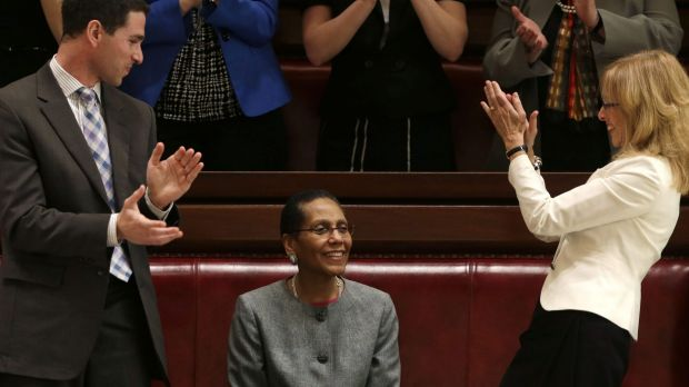 Justice Sheila Abdus-Salaam, centre, after her confirmation to serve on the New York State Court of Appeals in 2013.