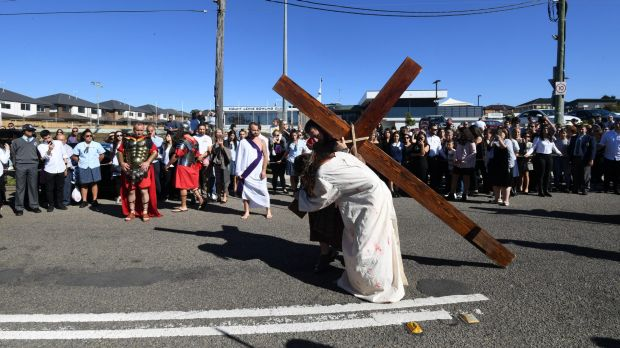 Thousands watch the Stations of the Cross re-enactment in Punchbowl.