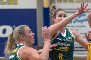 Sara Blicavs and Steph Cumming in action for the Dandenong Rangers.