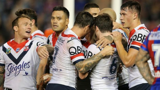 Team effort: The Roosters celebrate another try at McDonald Jones Stadium.