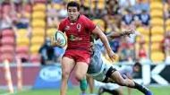 BRISBANE, AUSTRALIA - APRIL 15:  Izaia Perese of the Reds breaks away from the defence during the round eight Super ...
