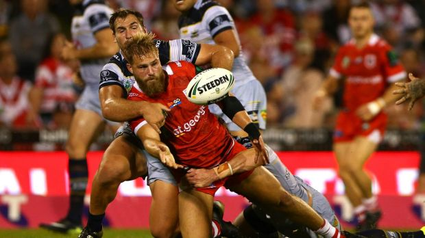 Getting one away: Jack de Belin offloads in the tackle.