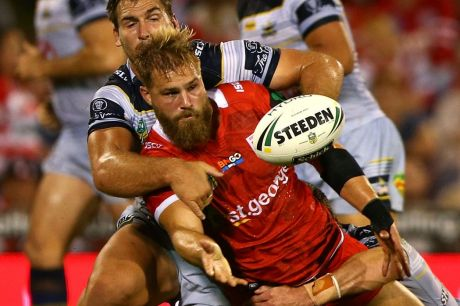 Pass mark: Jack de Belin offloads against the Cowboys. The Dragons have the highest number of offloads in 2017.