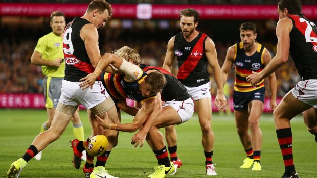 Crow sandwich: Matt Crouch is tackled by Brendon Goddard (left) and Darcy Parish.