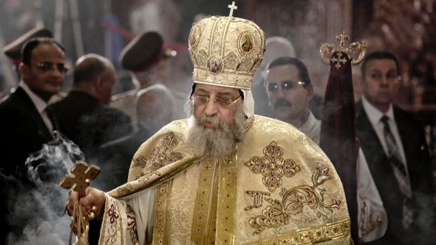 Egyptian Coptic Pope Tawadros II leads prayers during the Easter Eve service at St Mark's Cathedral in Cairo a week ...