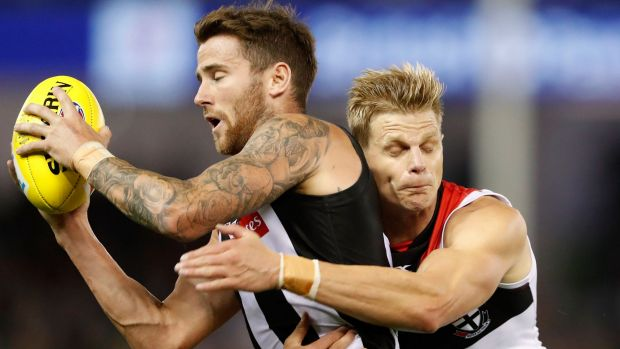 Magpie Jeremy Howe is tackled by the evergreen Nick Riewoldt.