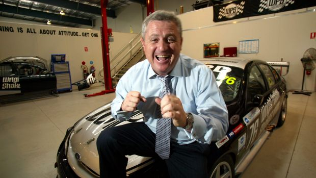 Craig Gore in happier times with one of WPS Racing's V8 cars.