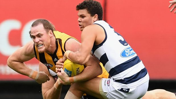 Jarryd Roughead tries to break free of Cat Brandan Parfitt's tackle.