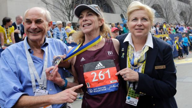 "Kathrine Switzer, centre, the first woman entrant in the Boston Marathon 50 years ago, ""survives"" this year's marathon, ..."