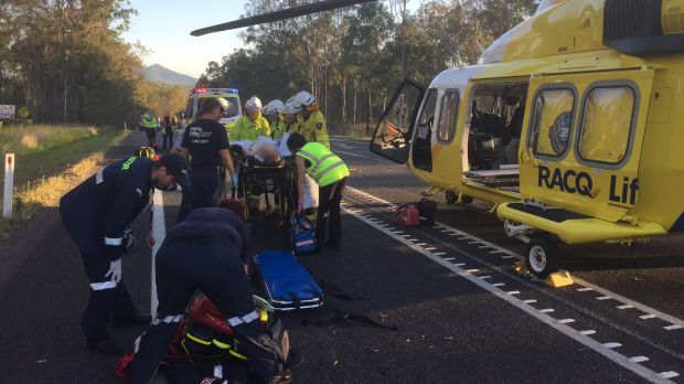 Patients are treated after a crash on the Bruce Highway south of Maryborough on Monday.