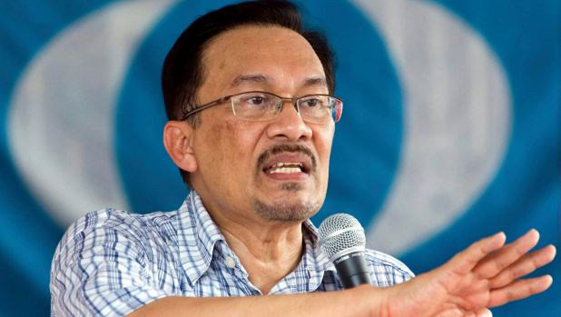 Malaysia's former deputy prime minister Anwar Ibrahim delivers a by-election campaign speech in 2007.