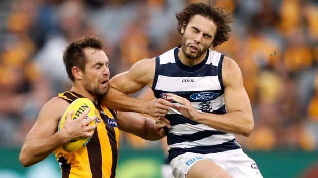 Geelong's James Parsons is in trouble for this bump on Luke Hodge.
