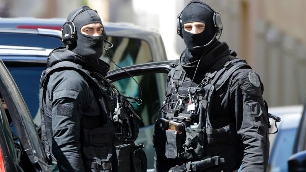 Hooded police officers involved in the arrest of two men in Marseille, southern France.