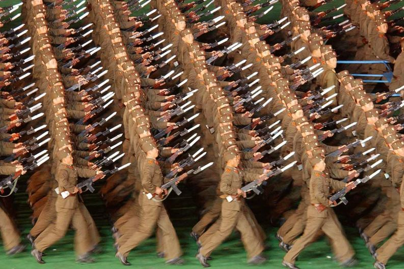 North Korean soldiers holding rifles march during the opening event of Arirang Festival to celebrate the 90th ...