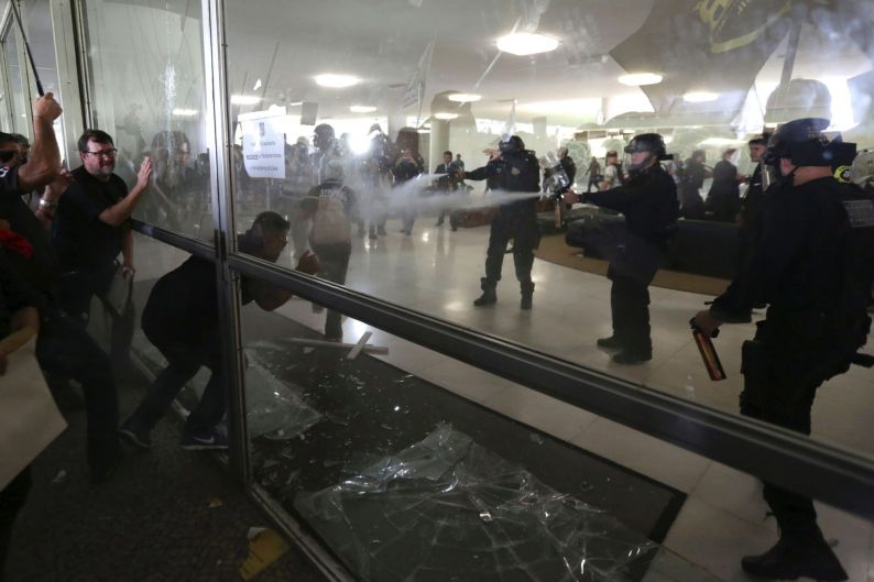 Police officers attempt to break into the Brazilian National Congress during a protest by police officers from several ...