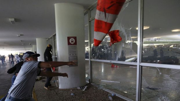 Police officers attempt to break into the Brazilian National Congress during a protest by officers from several ...