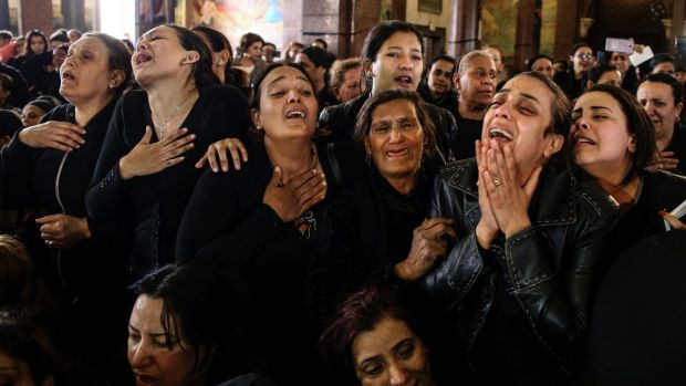 Women cry during the funeral for those killed in a Palm Sunday church attack in Alexandria, Egypt.