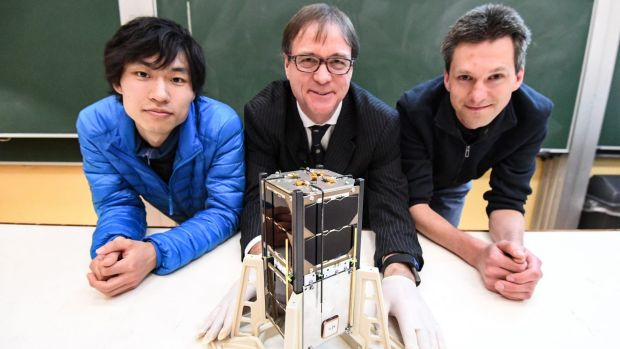 Iver Cairns (centre), Jiro Funmoto and Wayne Peacock with the Inspire-2 cubesat.