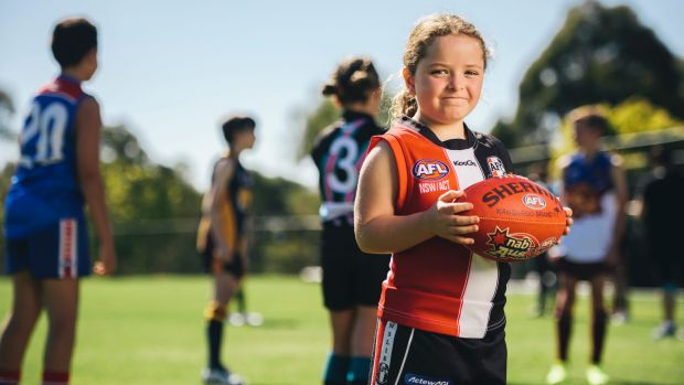 Ainslie player Elise Doherty, 7, is part of a booming footy resurgence.