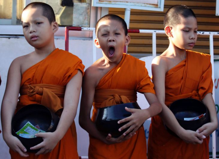 One of novice Buddhist monks yawns during a merit in Bangkok, Thailand. Thai men are expected to enter the monkhood at ...