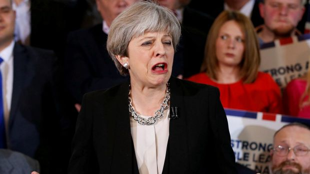 Britain's Prime Minister Theresa May delivers a speech to Conservative Party members to launch their election campaign ...
