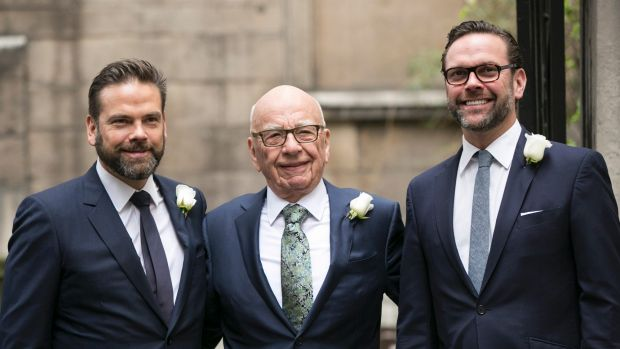 James Murdoch (right), with brother Lachland and father Rupert, will join Tesla's board.