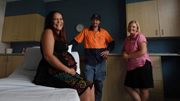 Kelly Jenkins with her partner James Burns and midwife Vanessa Smith.