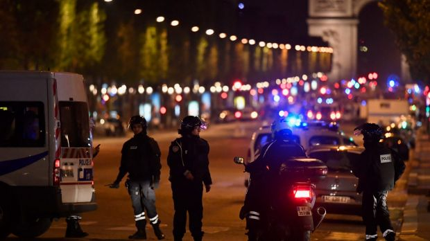 Police officers secure the area after a gunman opened fire on Champs Elysees.