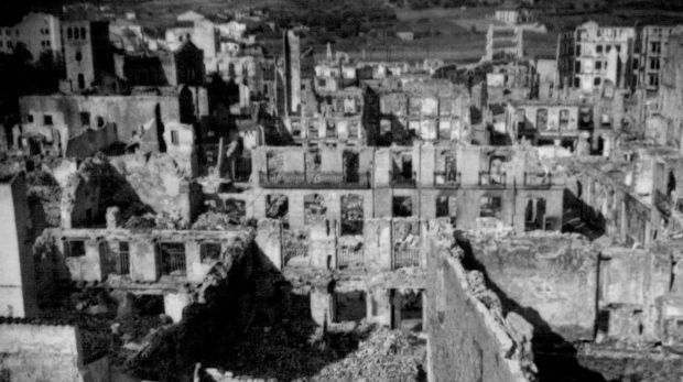 Guernica in ruins in 1937, after it became the world's first civilian population centre to be carpet bombed.