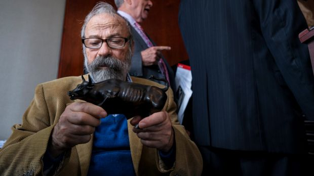 Arturo Di Modica holds a model of his <em>Charging Bull</em> sculpture during a news conference in New York this month.