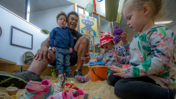 Gungahlin Eagles rugby player Pat Tuidraki at his day job as a childcare worker.