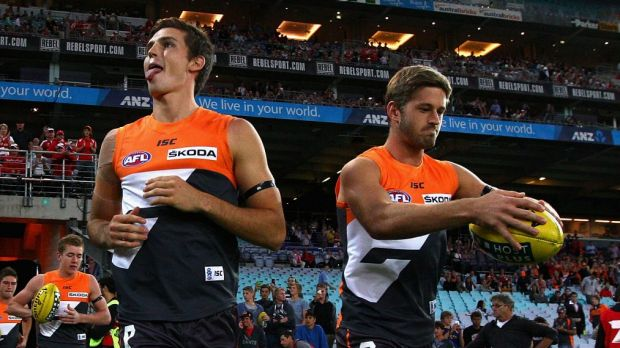 Tough start: Phil Davis and Callan Ward run out onto the field during the round one match between the  Giants and the ...
