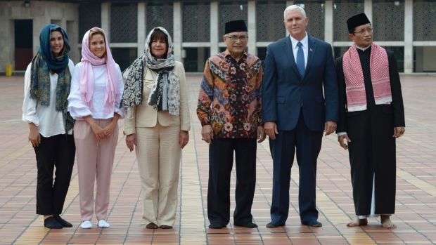 Mike Pence with, from left, his daughters Audrey and Charlotte, wife Karen and dignitaries at the Istiqlal Mosque, Jakarta.
