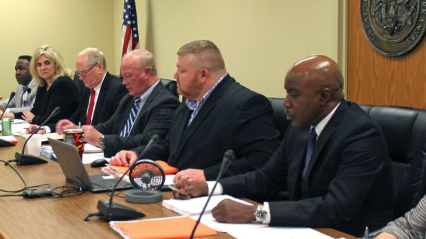 Stacey Johnson and Ledell Lee had asked the Arkansas Parole Board, pictured, to recommend that Governor Asa Hutchinson ...
