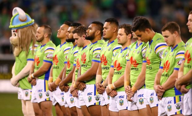 Raiders players line up for the ANZAC ceremony.