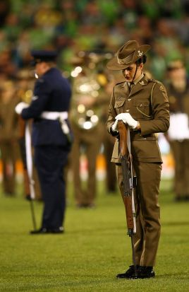 Australian service men and women perform the ANZAC ceremony before the round eight NRL match between the Canberra ...