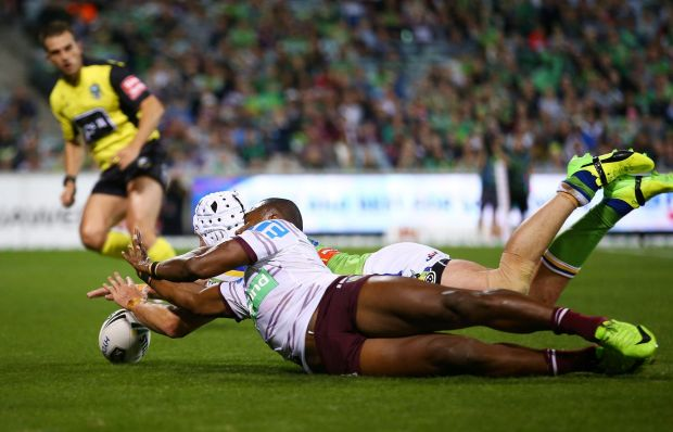 Jarrod Croker of the Raiders dives to score a try.