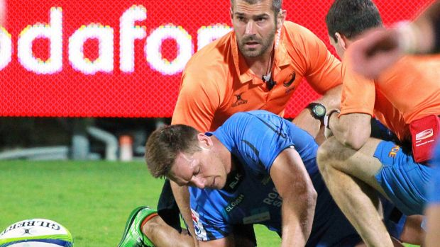 Sore one: Dane Haylett-Petty receives treatment in the first half.