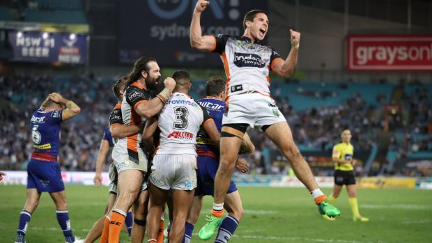 Magic moment: Aaron Woods, Michael Chee-Kam and Mitch Moses of the Tigers celebrate.