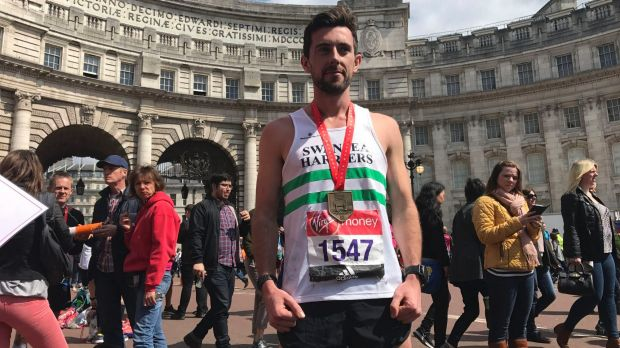 Matthew Rees, 29, from Swansea, carried an exhausted fellow athlete over the London Marathon finishing line.