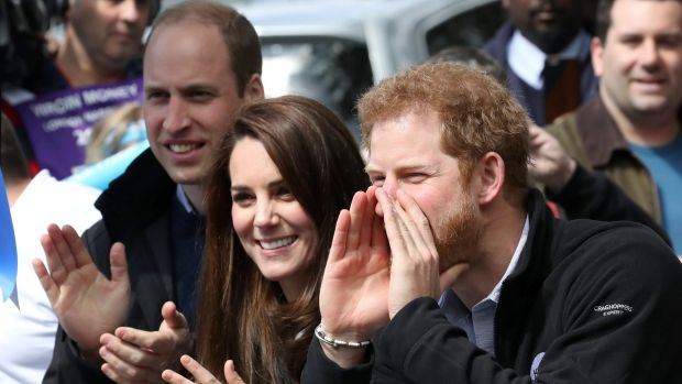 Prince William, Kate and Prince Harry cheer on runners at the finishing line.