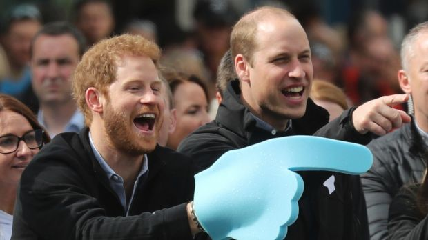 Prince Harry and Prince William urge on runners at the end of the London Marathon.