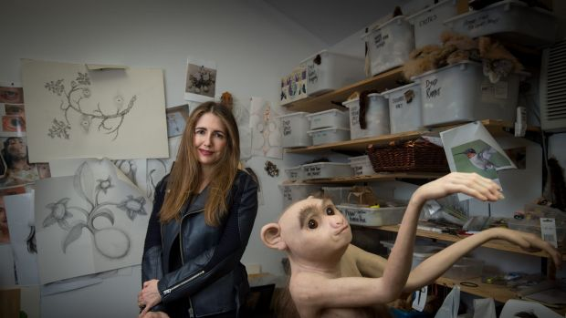 Patricia Piccinini in her Collingwood studio with one of her new pieces, The Pollinator.
