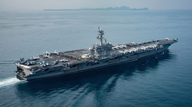 In this Saturday, April 15, 2017 photo released by the U.S. Navy, the aircraft carrier USS Carl Vinson transits the ...