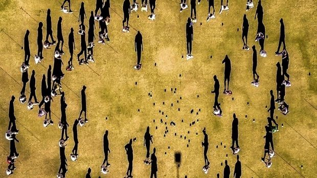 The drone perfectly captured the shadows of each bowler as they walked to collect their bowls.