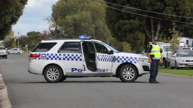 Police block the street in Wangaratta on Tuesday.