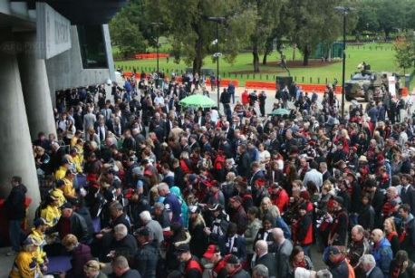 AFL fans filing into the MCG on Tuesday for the Anzac Day blockbuster between Essendon and Collingwood.